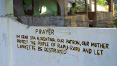anti mining prayer on church wall