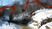 Diggers blocking off flow in streams contrary to permits