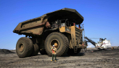 400 tonne trucks extract ferry the oil sands from the mine
